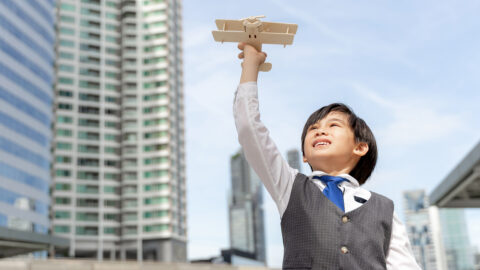 young-boy-playing-aviator-toy-air-plane-imagination-dreaming-being-pilot-future-business-district-urban